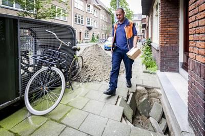 Linke kuilen in Rotterdamse straten na forse hoosbuien