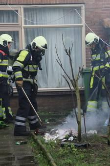 Buurman ontdekt brandende stapel papieren in woning Cuijk
