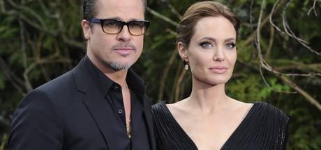 Angelina en Brad om de tafel voor scheiding