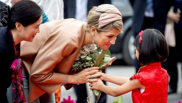 Koningin Máxima tijdens het bezoek aan het Sino--Dutch Diary Development Center. Beeld anp