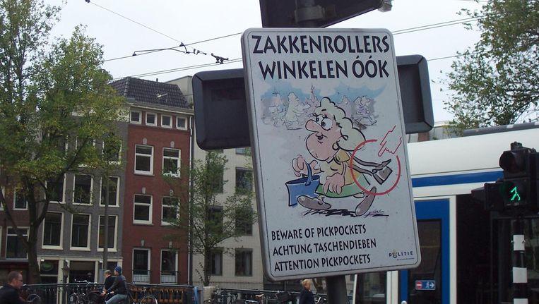 De politie waarschuwt voor zakkenrollers. Beeld Alberto Garcia via Flickr.com
