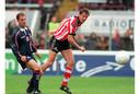 Van der Laan scoort in 1997 tegen Ajax. Ronald de Boer (l) is te laat.