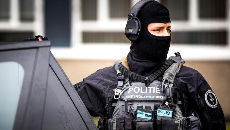 Een agent van de Dienst Speciale Interventies. Beeld ANP
