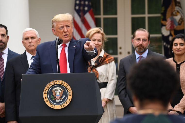 Donald Trump tijdens de persconferentie.  Beeld AFP