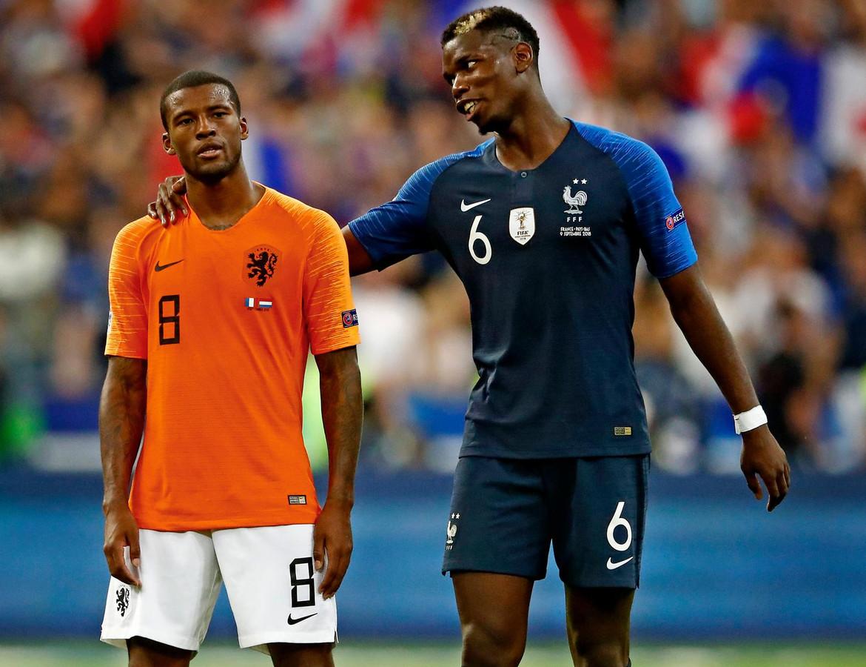 Georginio Wijnaldum en Paul Pogba na de wedstrijd.