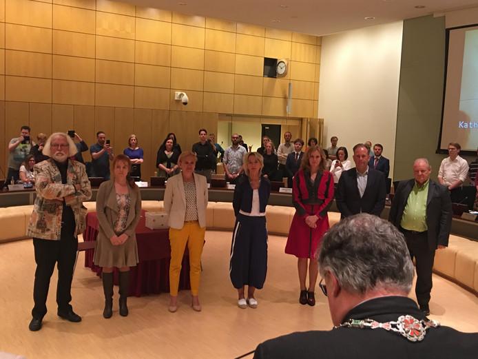 De zeven nieuw geïnstalleerde wethouders van de gemeente Nijmegen, helemaal links Bert Velthuis.
