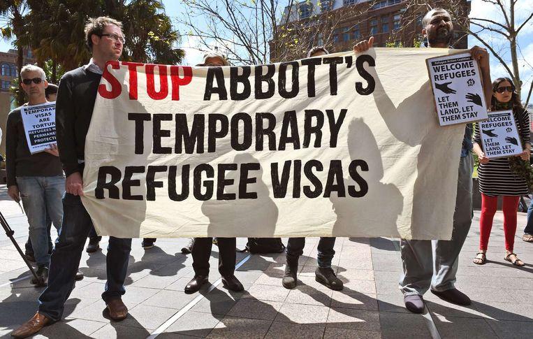 Demonstranten protesteren tegen de omstreden plannen van de Australische regering. Beeld afp