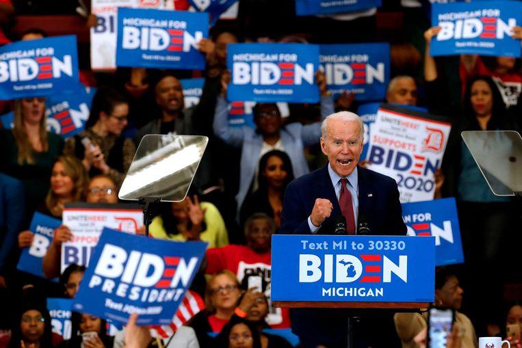 Een bijeenkomst van aanhangers van Joe Biden in Michigan. Beeld AFP