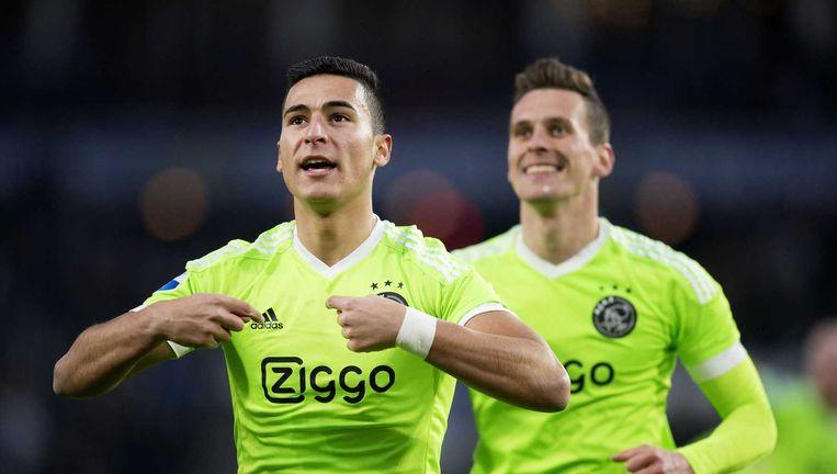 El Ghazi en Milik vieren de tweede goal. Beeld anp