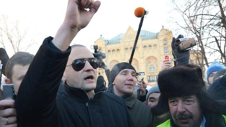 Oppositieleider Sergei Ugaltsov, vandaag in Moskou. Ook hij werd opgepakt. Beeld afp