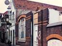 Mariposa, de oude gevel, later plek van stadsparkje de Valkhof waar nu tien witte stadswoningen staan.