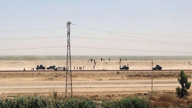 Het Iraakse leger trekt zich terug uit Ramadi. Beeld ap