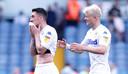 Spelers van Leeds United balen na de nederlaag tegen Wigan Athletic.