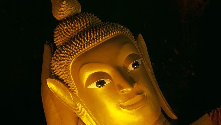 Celstraf voor Boeddha met koptelefoon. Beeld anp