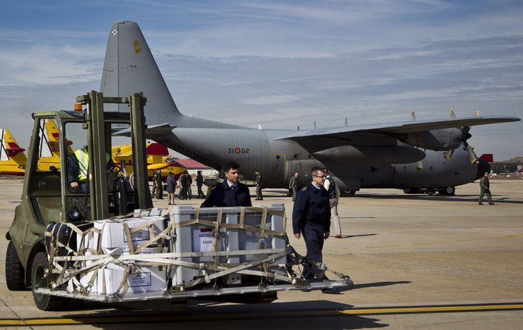 Een C-130 waarmee de lichamen worden vervoerd. Beeld null