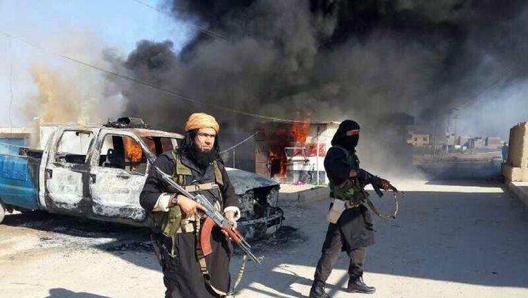 Abu Wahib in januari 2014 bij een aanval van IS in Irak. Beeld AFP