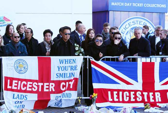 epa07129202 Aiyawatt Srivaddhanaprabha (C-R) and Aimon Srivaddhanaprabha (C-L), the son and wife of Leicester City's Thai chairman Vichai Srivaddhanaprabha react outside the King Power stadium in Leicester, Britain, 29 October 2018. According to reports on 27 October 2018, a helicopter of Leicester City owner Vichai Srivaddhanaprabha, has crashed and burst into flames outside King Power Stadium in Leicester after the Premier League soccer match between Leicester City and West Ham United. Leicestershire Police state on 29 October 2018 that the five people were on board the helicopter when the incident happened. While formal identification has not yet taken place, they are believed to be Leicester City Football Club chairman Vichai Srivaddhanaprabha, two members of his staff, Nusara Suknamai and Kaveporn Punpare, pilot Eric Swaffer and passenger Izabela Roza Lechowicz.  EPA/TIM KEETON