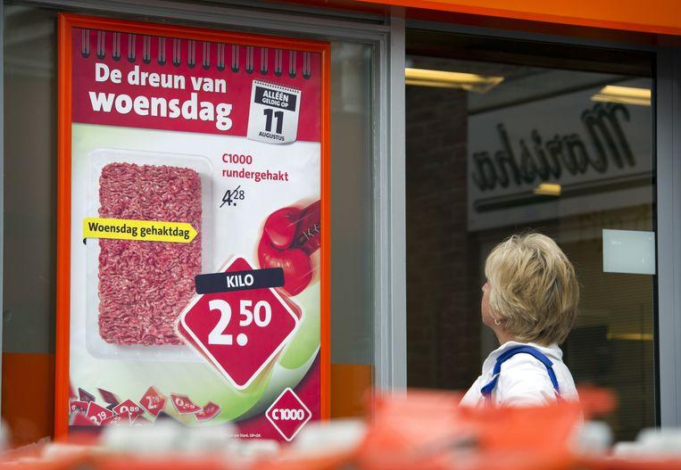 Reclame voor vlees bij een supermarkt. Beeld ANP