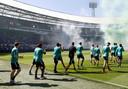Spelers betreden de Kuip tijdens de eerste openbare training van Feyenoord voor het seizoen 2020-2021.