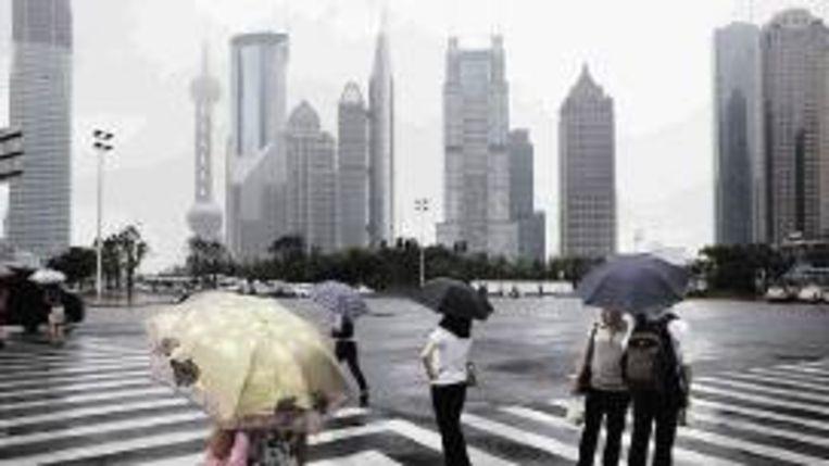 Het financiële district van Shanghai. (EPA) Beeld