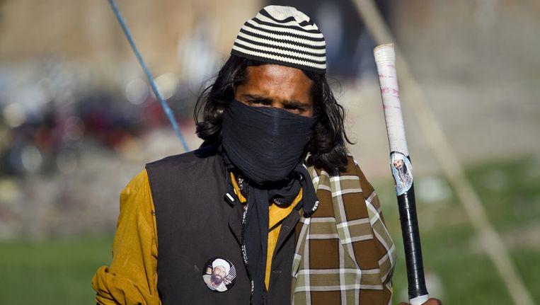 Een gemaskerde Taliban-strijder Beeld ap