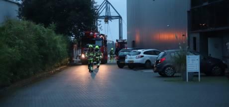 Bedrijf ontruimd in Niftrik, olie op hete motor zorgt voor rook