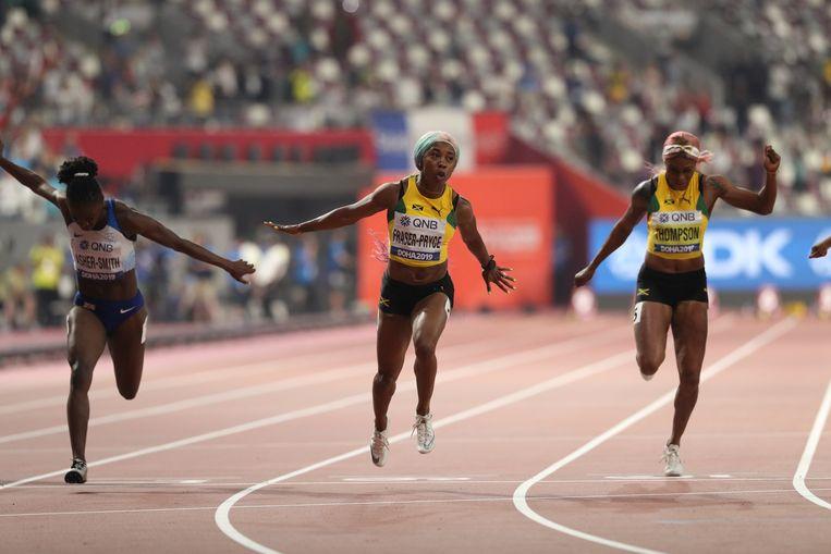 Shelly-Ann Fraser-Pryce of Jamaica wint de finale van de 100 meter sprint tijdens de WK in Doha. Beeld Getty Images