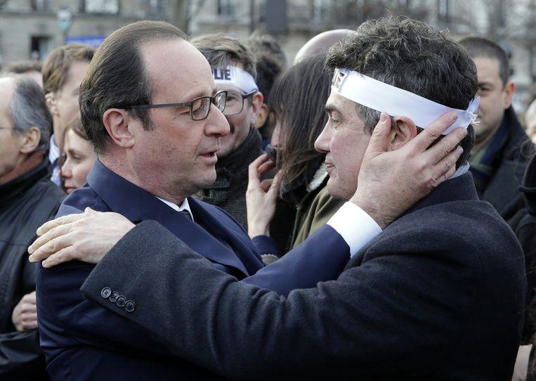 Patrick Pelloux, een columnist van Charlie Hebdo die de aanslag overleefde. Beeld AFP