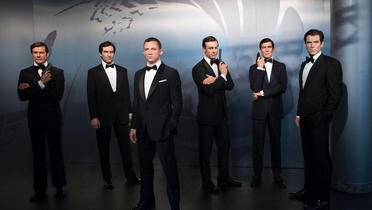 De wassen beelden Bond-acteurs Roger Moore, Timothy Dalton, Daniel Craig, Sean Connery, George Lazenby en Pierce Brosnan in Madame Tussauds Berlijn. Beeld afp