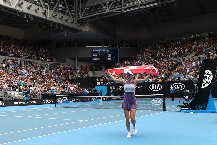 Wozniacki na haar partij met de Deense vlag.
