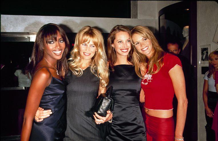 Naomi Campbell, Claudia Schiffer, Christy Turlington en Elle Macpherson op de opening van het Fashion Café in NYC in 1995.