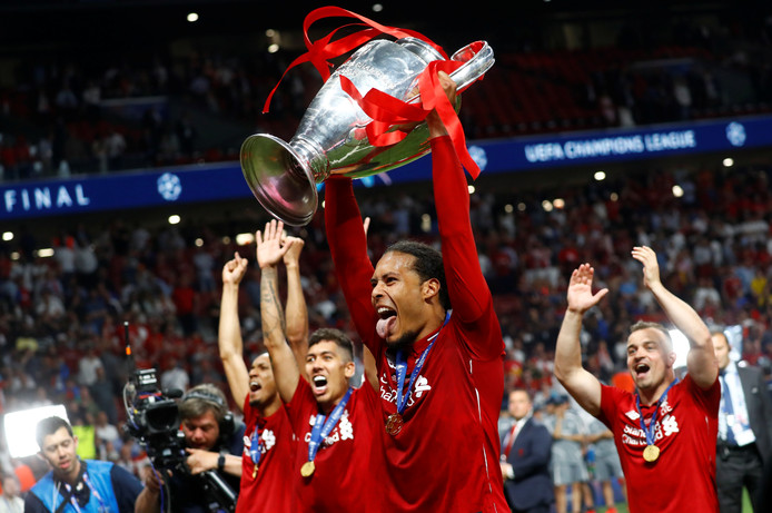 Soccer Football - Champions League Final - Tottenham Hotspur v Liverpool - Wanda Metropolitano, Madrid, Spain - June 1, 2019  Liverpool's Virgil van Dijk celebrates with the trophy after winning the Champions League  REUTERS/Kai Pfaffenbach