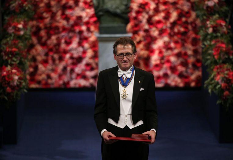 Ben Feringa ontvangt de Nobelprijs voor Scheikunde in Stockholm, december 2016. Beeld AFP/Soren Andersson