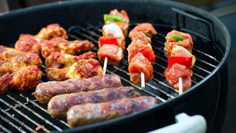 Vlees op de barbecue. Beeld anp