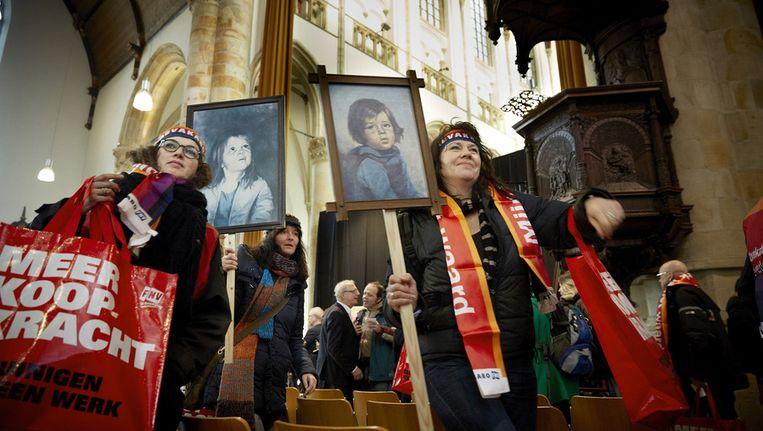Jeugdwerkers protesteren in de Grote Kerk in Den Haag tegen de nieuwe Jeugdwet, eind januari. Beeld anp