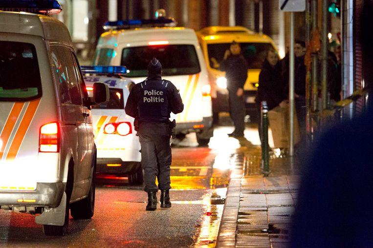 Huiszoekingen in Molenbeek na de aanslagen in Parijs. Beeld photo_news