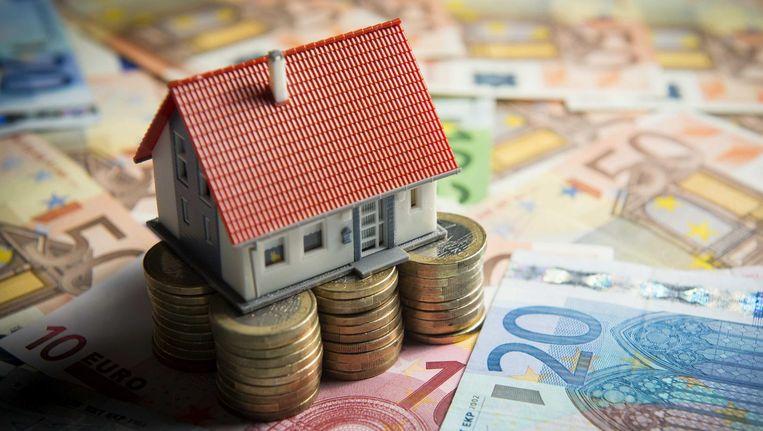 Huurders zijn dit jaar gemiddeld 3 euro minder kwijt dan vorig jaar, huiseigenaren betalen 1 euro minder. Beeld null
