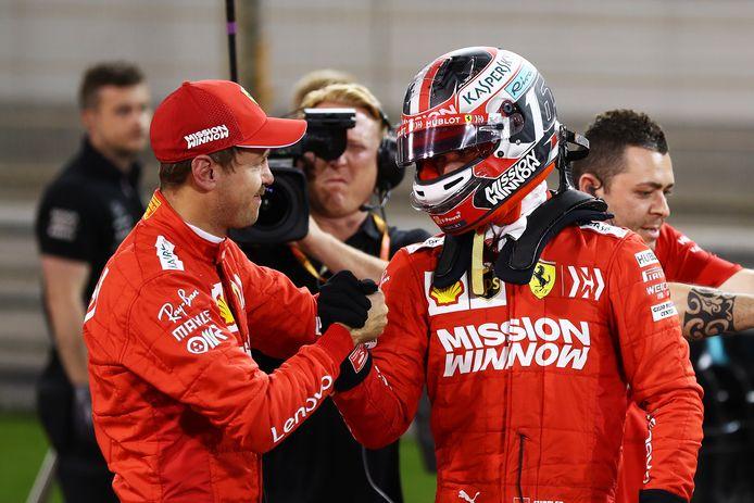 Leclerc neemt de felicitaties van teamgenoot Vettel in ontvangst.