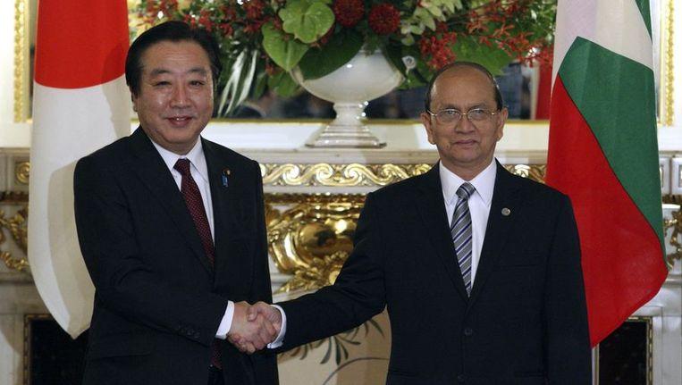 De Japanse premier Yoshihiko Noda (L) en de Myanmarese president Thein Sein. Beeld reuters
