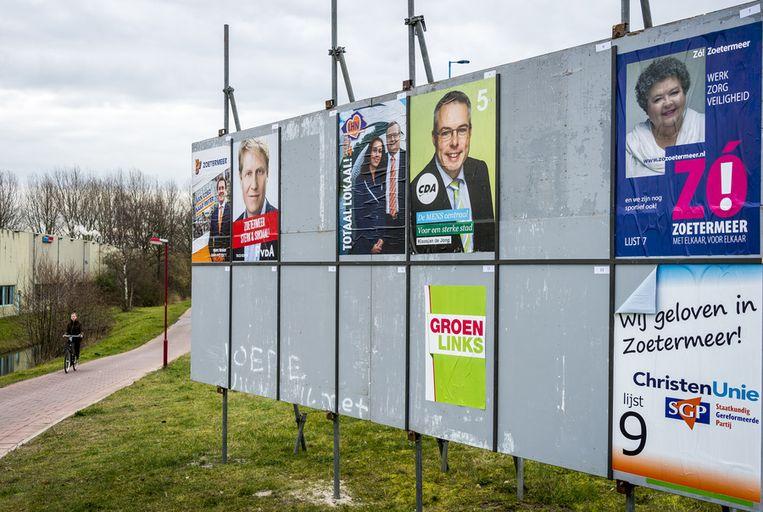 Billboards met affiches voor de komende gemeenteraadsverkiezingen. Beeld anp