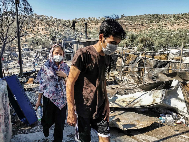 Migranten in kamp Moria na de brand.