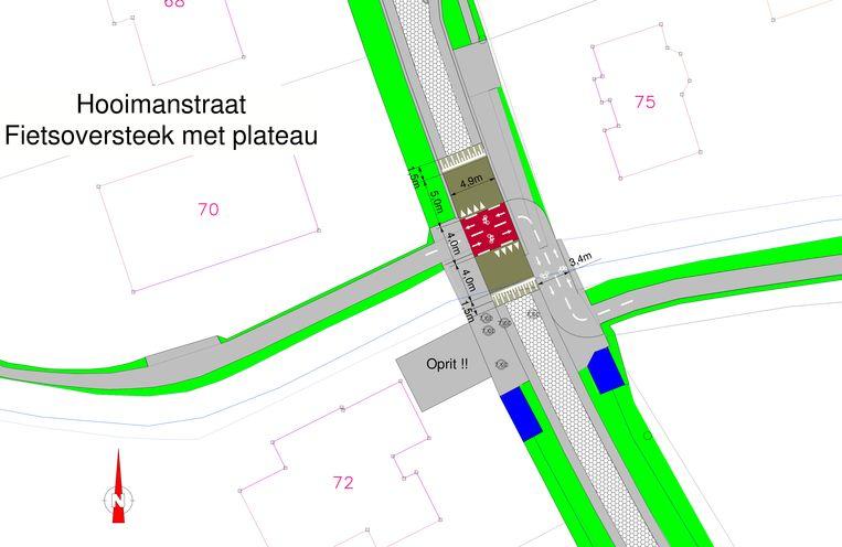 Het kruispunt van de Hooimanstraat met de Belselewegel in Sinaai, waar vanaf volgende week een fietsoversteek wordt ingericht.