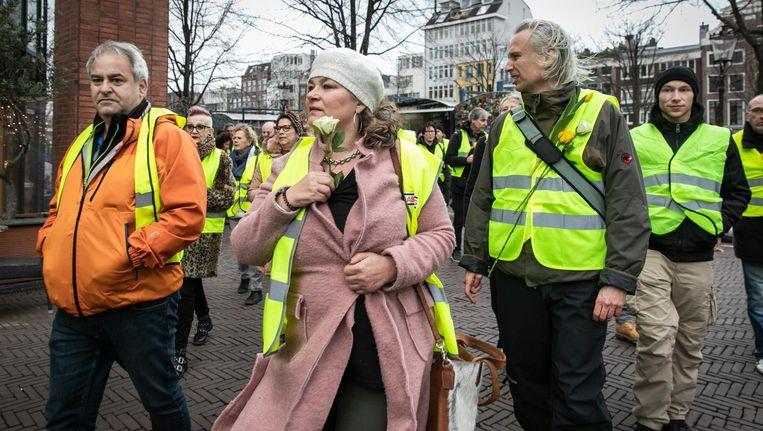 Deelnemers aan de demonstratie zaterdag bij de Stopera. Beeld Dingena Mol