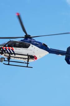 Politie zoekt in Tilburg met helikopter naar inbreker(s) nadat bewoonster ze betrapte