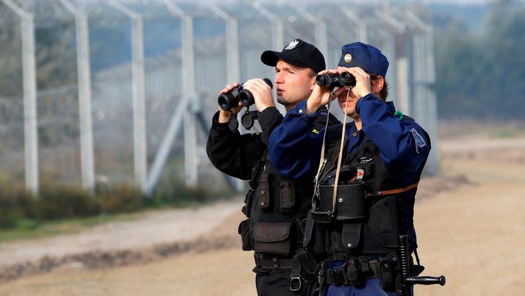Een Hongaars-Poolse patrouille langs de grens in 2016. Polen, Hongarije, Slowakije en Tsjechië willen af van de EU-asielquota Beeld reuters