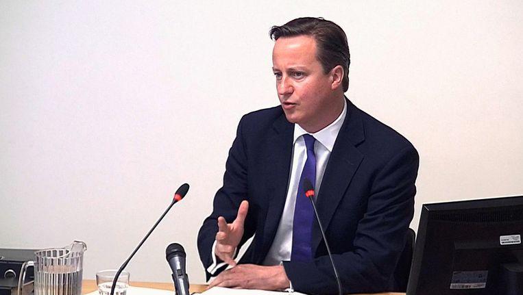 Cameron, vanmorgen voor de mediacommissie Beeld ap