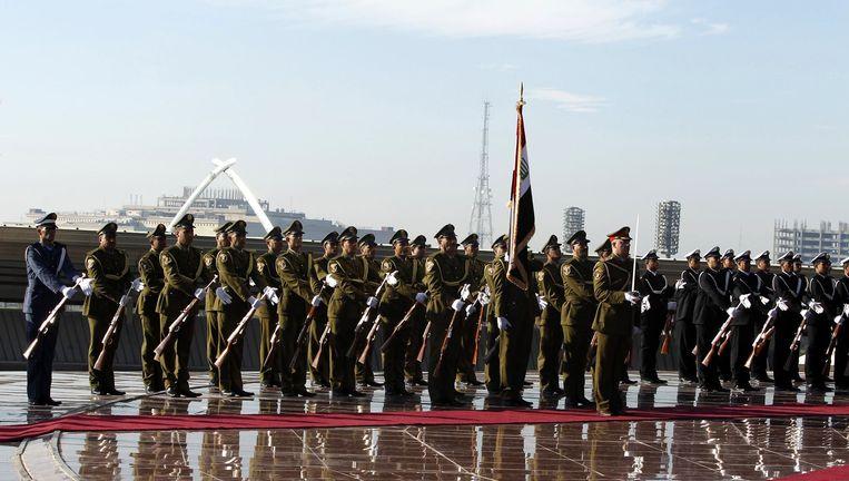 Soldaten tijdens een legerparade in Bagdad. Beeld reuters