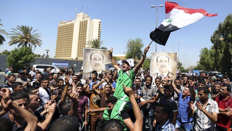 Aanhangers van de zittende premier al-Maliki protesteren in Bagdad. Vandaag vroeg president Fouad Massoum de vice-voorzitter Haider al-Abadi om een nieuwe regering te vormen, waarmee hij Maliki passeerde. Beeld ap