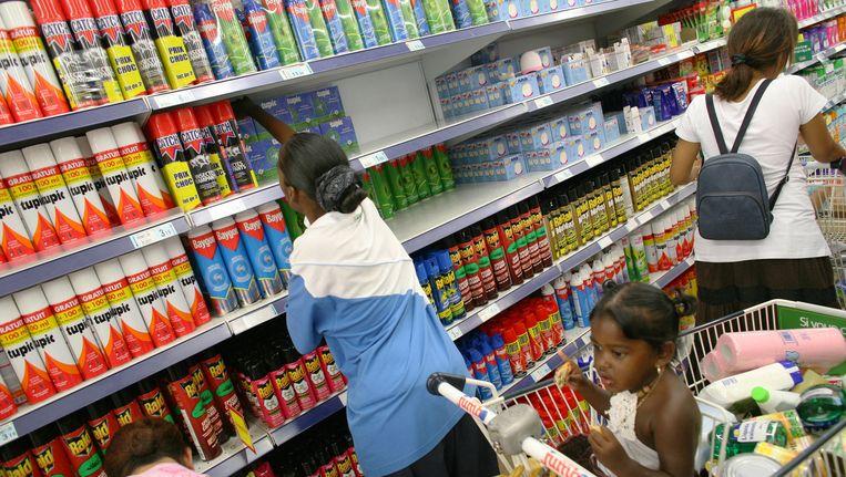 Antimuggenmiddelen zijn niet aan te slepen in Brazilië. Beeld anp