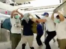 Zes gemaskerde mannen aangehouden voor aanval op demonstranten Hongkong
